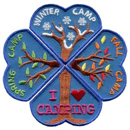Four heart shaped patches are placed so they form a four-leaf clover. The bottom most heart contains the trunk of a tree with the words 'I Love Camping'. The left heart is pictured with two tree branches beginning to bud. The words 'Spring Camp' is embroidered on it. The top heart has snowflakes and snow covered tree branches. The words 'Winter Camp' are embroidered on the patch. The right heart has the words 'Fall Camp' and pictures tree branches that are loosing their leaves.