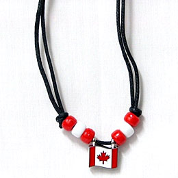 black string necklace with a canada flag charm and red and white beads