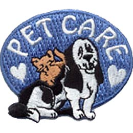 A blue horizontal oval forms the background of this patch. The words ''Pet Care'' begin and end with a heart as the letters arch along the top of the oval. A dog and a cat sit underneath the word arch.