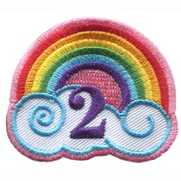 This patch has a rainbow arching over a white cloud with blue outlines. The number ''2'' is embroidered under the rainbow's arch.