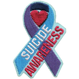 The purple and blue suicide awareness ribbon is displayed with a red heart inside the curl of the ribbon. The fore of the ribbon is blue and has the word 'Suicide' on it. 'Awareness' sits just underneath at the same angle.