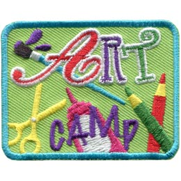 This green patch has the words ''Art Camp'' embroidered on it. The ''Art'' portion is written in a flowing script and the letters are red, purple, and green respectively. Scissors, pencil crayons, a bottle of glue, and a paintbrush lie in the background.