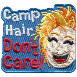 The words 'Camp Hair Don't Care' stack on top of one another and are embroidered next to a smiling girl with really messy blonde hair.