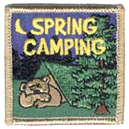 A bear is sound asleep in a green tent, deep in an evergreen forest. A crescent moon lights up the night sky. The words ''Spring Camping'' are embroidered in yellow at the top of this square shaped patch.