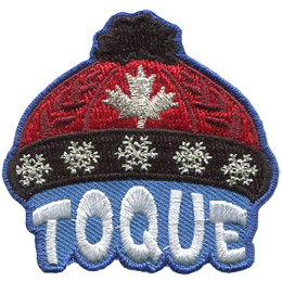 This red knit cap, called a 'Toque' in Canada, has a black pom-pom on the crown and a black brim with silver metallic snowflakes. A Canadian maple leaf is displayed on the center of the red hat. The cap is sitting on the word 'Toque'.