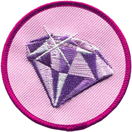This circular badge has an image of a glittering amethyst on a pink background.