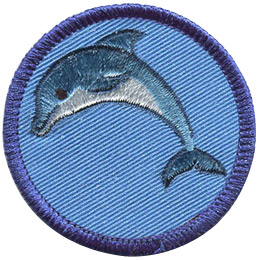 This round badge displays a blue dolphin with a white belly curved in an inverted 'U' position with it's tail on the right and head on the left.