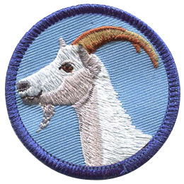 This merrow bordered circle badge displays the profile of a white goat with arching horns.