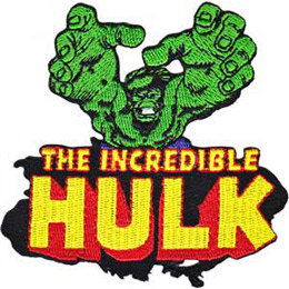 The character Hulk reaches out from the patch. The words 'The Incredible Hulk' rest underneath.