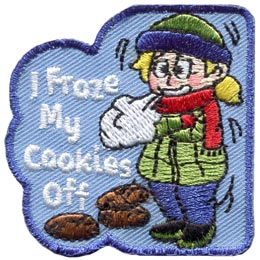 A young girl is bundled up in a hat, scarf, jacket, and thick pants as she stands shivering in the cold. Three cookies lie under the text ''I Froze My Cookies Off.''