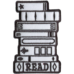 A stack of 8 books is outlined in black thread, with the bottom book titled 'Read'.