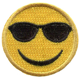 A yellow circle forms a smiley face with sunglasses eyes and a big U-shaped smile.