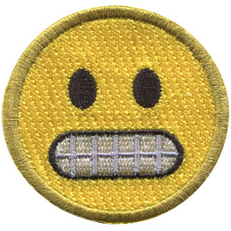A yellow circle forms an emoji with wide black eyes and gritted teeth.