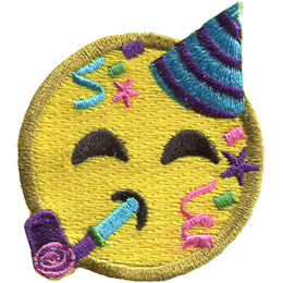 A yellow circle forms an emoji face wearing a birthday hat and blowing on a birthday horn. Streamers, confetti, and stars rain down on either side of its face.