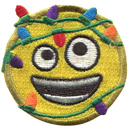 This round, yellow emoji face has two different sized eyes (one looking up and the other looking down) and a wide open, smiling mouth. Multi-coloured Christmas lights are tangled around this emoji.