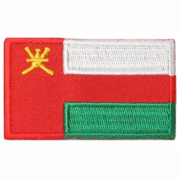 The national flag of Oman consists of three stripes (white, green and red) with a red bar on the left that contains the national emblem of Oman (a dagger and two swords).