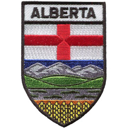 This shield shaped badge is broken into three horizontal sections. The top most bar has the name 'Alberta'. The second section has a white background with a red cross splitting the background into four even quarters. The last section has blue sky, mountains, green hills, and a field of golden wheat at the bottom.