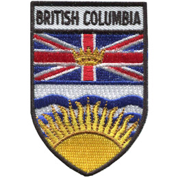 This shield shaped crest is broken up into three horizontal parts. At the top is the words 'British Columbia,' underneath it is the B.C. flag, and at the bottom is a rising sun.