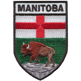 This shield shaped badge is broken into three horizontal sections. The top most bar has the name 'Manitoba'. The second section has a white background with a red cross splitting the background into four even quarters. The last section displays a buffalo standing on a rock with a green background behind it.