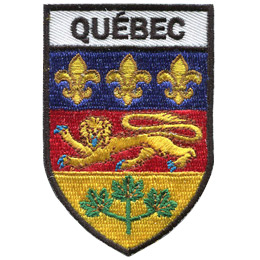 <p>This shield shaped crest is broken up into three horizontal parts. At the top is the word 'Quebec,' underneath it is the Quebec flag, and at the bottom are three green maple leaves joined together by one stem.</p>