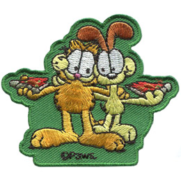 Garfield, the orange and black stripped, overweight house-cat, has one paw wrapped around his pal, Odie, and the other on a slice of pizza. Odie, the white dog with large, brown floppy ears, is holding a slice of pizza as well. The PAWS trademark sits at the bottom of the patch.