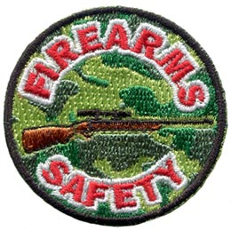 This light and dark green camouflage patch depicts a rifle with the words ''Firearms Safety'' embroidered in red and white.