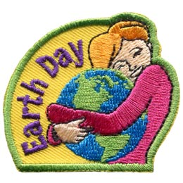 A women is show hugging the Earth and protectively holding it in her arms. The words 'Earth Day' are embroidered in an arch to the left of the graphic.