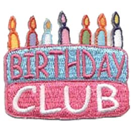 A two layered birthday cake is decorated with seven different coloured birthday candles. The word ''Birthday'' is written in pink on the top blue layer and ''Club'' is written in white on the bottom pink layer.