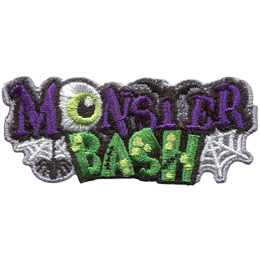 This crest is comprised of the word \'Monster\' stacked on top of \'Bash\'. A spider dangles from the letter \'M\', the \'O\' has been replaced by an eyeball, and the \'T\' is a bat with its wings outspread. \'Bash\' is covered in yellow warts and has stitches in the \'A\' and \'H\'.