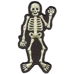 <p>A white skeleton waves at you with his left hand (the viewer's right). The skeleton is outlined by a black background.</p>