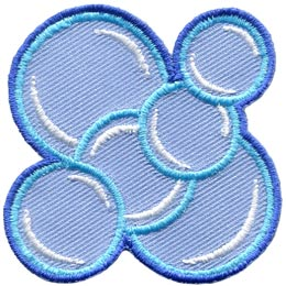 This patch is made from multiple soap bubbles. Two big bubbles sit diagonally from each other (one on the top left and one on the bottom right) with four smaller bubbles layered over top (going from top right to bottom left).