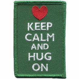 This green, rectangular patch has the words ''Keep Calm and Hug On'' embroidered in white thread. A red heart rests over the lettering.