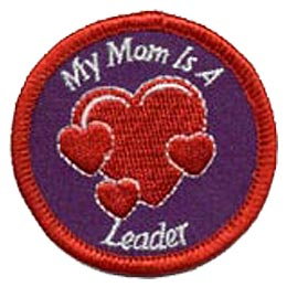 This circular patch has a thick red merrow border. The words ''My Mom Is A Leader'' circles a giant heart with three hearts around it.