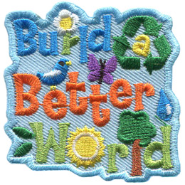 This crest has text that reads, 'Build a Better World.' The 'i' in 'build' is a white daisy. The 'a' is surrounded by the three green arrows of recycling, the 'e' and 't' in 'Better' has a bird and butterfly, respectively, sitting on top of the letter. The 'o' in 'world' is a sun, the 'l' is a tree,' and the 'd' has a drop of water overtop of it.