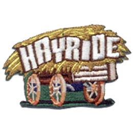 An old wooden wagon hauls a huge load of golden hay with the word ''Hayride'' embroidered in all capital letters.
