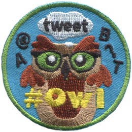 This brown owl is surrounded by social media speak and symbols. \\\\'\\\\'A, @, tweet, B, ?,\\\\'\\\\' and \\\\'\\\\'T\\\\'\\\\' float around the owl and the embroidered text \\\\'\\\\'# Owl\\\\'\\\\' is situated at the bottom of the patch.