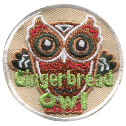 This owl is made of gingerbread. The image is of an owl cookie shape with the eyes, feathers, and outline of an owl decorated with icing. The text \'Gingerbread Owl\' sits near the bottom of this round patch.