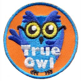 This blue, glasses wearing owl has his right wing over its heart and his left raised in the air. The words ''True Owl'' are embroidered at the bottom of this round patch.