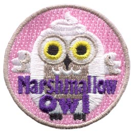 A white owl with a swirl on it's head stares out of the patch with big yellow eyes. The words 'Marshmallow Owl' are embroidered at the bottom of the badge.