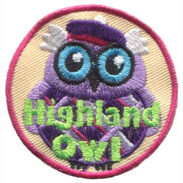 This wide-eyed bird is dressed in a checkered kilt and purple balmoral. The words ''Highland Owl'' are embroidered in green stitching.