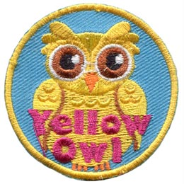 A yellow coloured owl is displayed with its wings closed at its side.