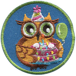 This golden owl is celebrating a birthday. A party hat sits on his head, a balloon is in the background on the right, and he is holding a decorated birthday cake in his wings.