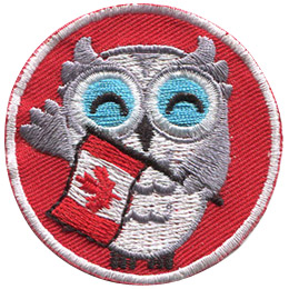 A grey and white owl holds a Canadian Flag and waves at the viewer. The background of this round patch is a bright red.