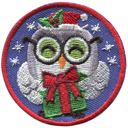 A grey and white owl holds a green present box wrapped with a red ribbon and a bow. It has a Santa hat, decorated with holy berries, and a pair of black rimmed glasses. Stars sparkle in the background of this round patch.
