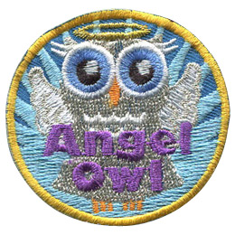 This grey owl is depicted like an angel, with a grey dress and angel wings sprouting from her back. A golden ring hovers over her head and a blue starburst shines behind her. The words 'Angel Owl' is embroidered at the bottom.
