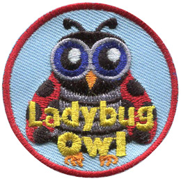This owl is disguised as a lady bug. It has big blue eyes, antenna, and black-spotted red wings.