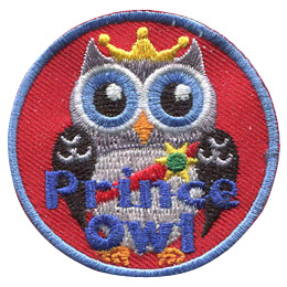 This regal prince owl wears a golden crown and a red sash pinned with a sun shaped medal.