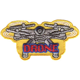 A quadcopter style drone hovers on a yellow background. The word 'Drone' is embroidered under the remote machine in red thread.