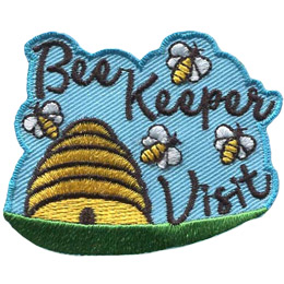 A bee hive sits on a green plain and has a sky blue background. Above and to the right of the hive are the words \'Bee Keeper Visit\'. Four bees fly around both the hive and words.