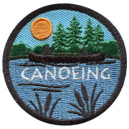 The silhouette of a person canoeing on a peaceful lake surrounded by forest scenery is displayed on this round patch.